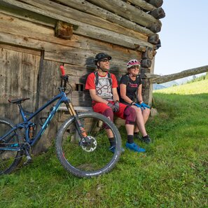 Mountain bikers enjoy the view from a mountain hut in Kappl
